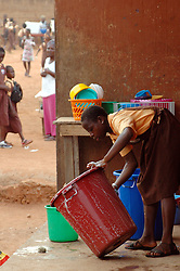 Ghana, Accra, Kokomlemle, 2007. An elementary school student takes her turn during a mornnig cleanup at Kwameh Nkrumah Memorial School.