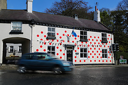 © Licensed to London News Pictures. 29/04/2016. Pateley Bridge, UK. A house covered in red polka dots on the route of the Tour De Yorkshire in Knaresborough, North Yorkshire. The three-day road cycling race held annually across Yorkshire is in it's second year. Photo credit : Ian Hinchliffe/LNP