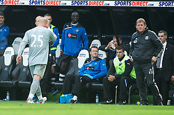 NEWCASTLE-UPON-TYNE, ENGLAND - Sunday, April 1, 2012: Liverpool's goalkeeper Jose Reina walks off dejected past manager Kenny Dalglish after being sent off against Newcastle United during the Premiership match at St James' Park. (Pic by David Rawcliffe/Propaganda)