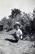 little boy posing while playing outside France vintage