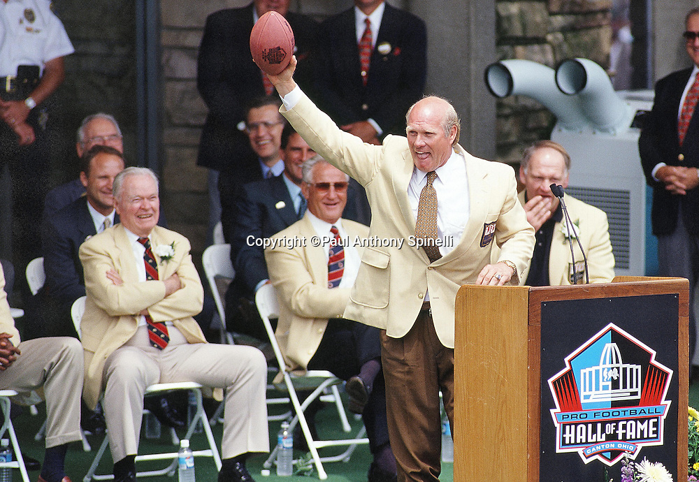 Former Pittsburgh Steelers quarterback Terry Bradshaw waves during his Pro Football Hall of Fame Induction speech before the Minnesota Vikings NFL football game against the Seattle Seahawks on July 26, 1997 in Canton, Ohio. The Vikings won the game 28-26. (©Paul Anthony Spinelli)