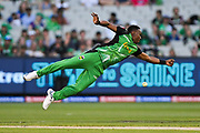 14th January 2019, Melbourne Cricket Ground, Melbourne, Australia; Australian Big Bash Cricket, Melbourne Stars versus Hobart Hurricanes;  Dwayne Bravo of the Melbourne Stars dives for the ball