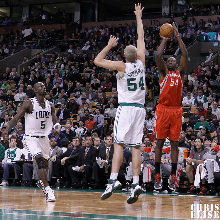 06 March 2012: Houston Rockets power forward Patrick Patterson (54) takes a jump shot over Boston Celtics center Greg Stiemsma (54) during the Boston Celtics 97-92 (OT) victory over the Houston Rockets at the TD Garden, Boston, Massachusetts, USA.