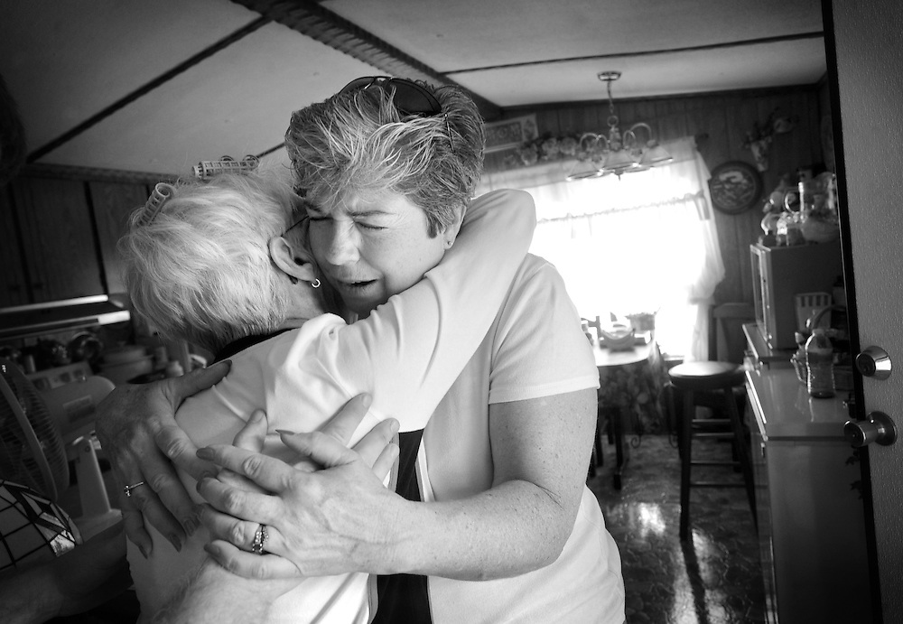 Cheryl Randall hugs Beulah Abbott while praying for her upcoming doctors appointment concerning her heart while delivering a box of food to her in Madison Heights.  The Randall's belief is to not just feed the person's stomach but also their souls by offering prayer, spiritual guidance and weekly church many church services throughout the week.