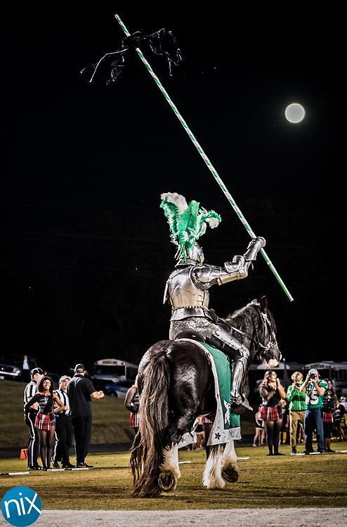 Kannapolis' Green Knight rides on to the field prior to the annual Battle for the Bell against Concord Friday night. Kannapolis won 14-12.