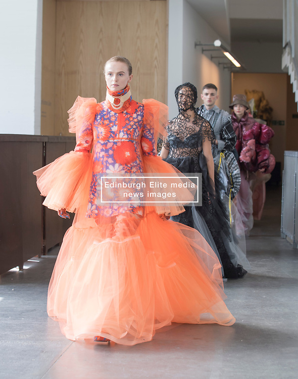 Pictured: models show the designs off before the degree show.<br /> <br /> Students studying fashion design at Glasgow School of Art previewed their work before their annual degree show.<br /> <br /> © Dave Johnston / EEm