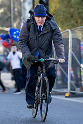 "© Licensed to London News Pictures. 11/03/2019. London, UK. Former Foreign Secretary Boris Johnson MP on his bicycle as he heads to Parliament. MPs will get a second ""meaningful vote"" on Prime Minister Theresa May's proposed Brexit deal tomorrow. Photo credit: Rob Pinney/LNP"