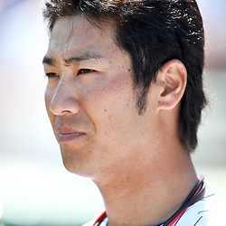 March 11, 2011; Fort Myers, FL, USA; Minnesota Twins second baseman Tsuyoshi Nishioka (1) looks on during a moment of silence for the victims of the Japan earthquake and tsunami before a spring training exhibition game against the Boston Red Sox at Hammond Stadium.   Mandatory Credit: Derick E. Hingle