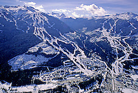 Whistler and Blackcomb Mountains rise up from the small Whistler Village, taken early 1990s.