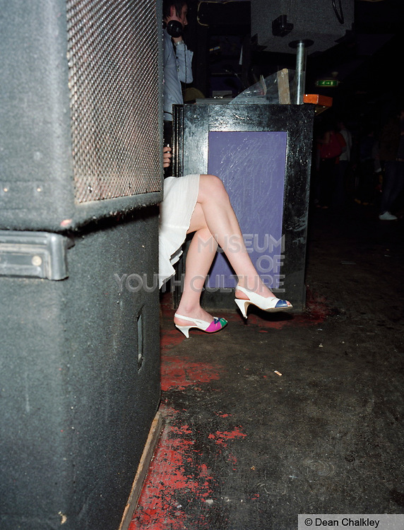 A Mod / Indie girl wearing retro, vintage clothes, sat down, The Junk Club, Southend, UK 2006