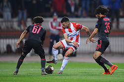 Nemanja Radonjic of Crvena Zvezda between Reiss Nelson and Mohamed Elneny of Arsenal during football match between NK Crvena Zvezda Beograd and Arsenal FC in Group H of UEFA Europa League 2017/18, on October 19, 2017 in Stadion Rajko Mitic, Belgrade, Serbia. Photo by Nebojsa Parausic / Sportida