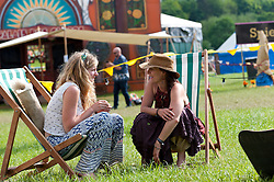 © Licensed to London News Pictures. 30/05/2016. Hay-on-Wye, Powys, Wales, UK. Festival-goers relax at the Riverside festival site on the fifth day of 'HowTheLightGetsIn' Festival of Ideas - The philosophy and music festival at Hay-on-Wye, Wales, UK. HowTheLightGetsIn festival was founded by post-realist philosopher and director of the Institute of Art and Ideas, Hilary Lawson. Photo credit: Graham M. Lawrence/LNP