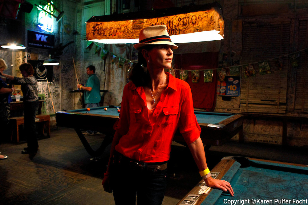 """Who Owns the Blues? - Repeat camper,  Lynda  Stirling left her job as an air traffic controller and traveled across the world from New Zealand to attend Blues Harmonica Jam Camp in Clarksdale, Mississippi.  She says she just can't  stay away, """"it's fun!"""" she says. """" It is not an exaggeration to say that it changed my life,"""" she said.  She is waiting her turn to go up on stage and wail on her blues harp at the Ground Zero Blues Club."""