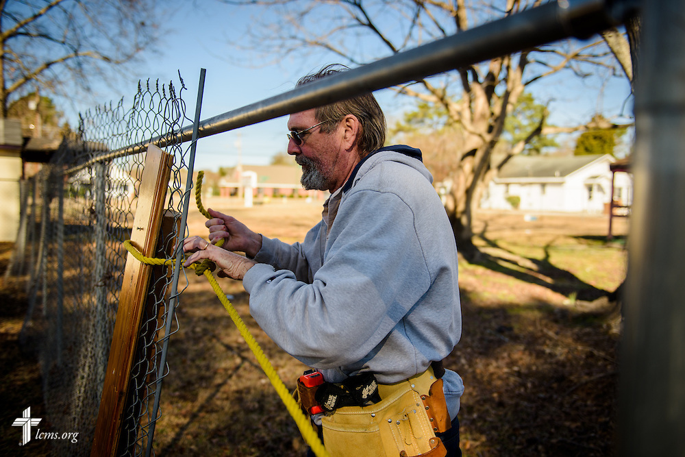Jim Kelliher, a volunteer from Hope Lutheran Church in Wake Forest, N.C., helps repair the fence at Nanny's Korner Care Center on Thursday, Jan. 19, 2017, in Lumberton, N.C. The center was damaged in October from flooding related to Hurricane Matthew. LCMS Communications/Erik M. Lunsford