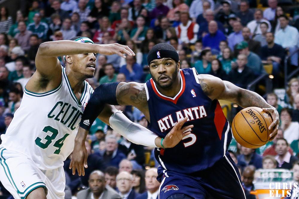 29 March 2013: Atlanta Hawks small forward Josh Smith (5) drives past Boston Celtics small forward Paul Pierce (34) during the Boston Celtics 118-107 victory over the Atlanta Hawks at the TD Garden, Boston, Massachusetts, USA.