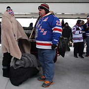 A fan dressed to keep warm on a bitterly cold day at Yankee Stadium during the New York Rangers Vs New Jersey Devils NHL regular season game held outdoors at Yankee Stadium, The Bronx, New York, USA. 26th January 2014. Photo Tim Clayton