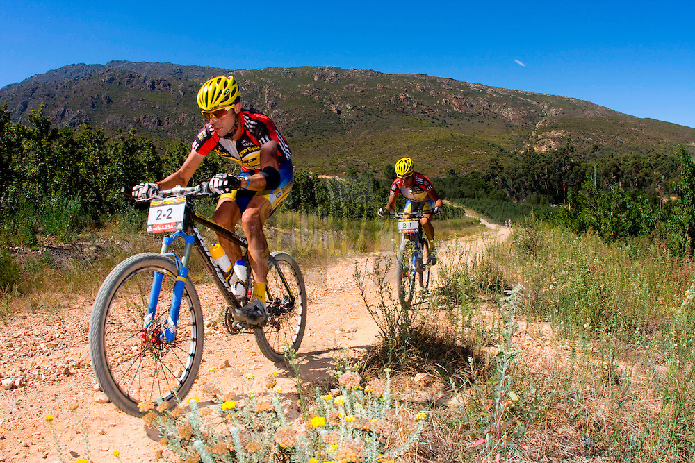 GORDON'S BAY, SOUTH AFRICA - David George and Kevin Evans during stage one of the Absa Cape Epic Mountain Bike Stage Race held between Gordon's Bay and Villiersdorp on the 22 March 2009 in the Western Cape, South Africa..Photo by Karin Schermbrucker / SPORTZPICS