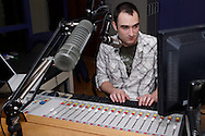 """Sean Martin on the air at WWSU-FM, the Wright State University radio station, Monday, May 2, 2011.  Martin opened his Monday 1990's themed show with """"Real American"""" by Rick Derringer, and using his Hulk Hogan voice said """"Even in the 90's, we were patriotic,"""" adding """"Osama is dead, brother.""""  Played from his personal collection via his laptop, the song was used as the entrance theme of Hulk Hogan in the WWF Tag Team."""