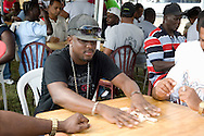 Locals playing dominoes in a park;  Anguilla, British West Indies, The Caribbean