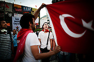 ISTANBUL. THE TURKISH PEOPLE OCCUPY TAKSIM SQUARE AGAINST THE DECISION OF PREMIER ERDOGAN TO DESTROY GEZI PARK IN THE CENTRE OF ISTANBUL IN ORDER TO BUILD A SHOPPING MALL. DURING THE NIGHT THE PROTESTERS ERECTED BARRICADES AGAINST THE TURKISH POLICE, THAT RESPONDED WITH TEAR GAS AND WATER HYDRANTS;