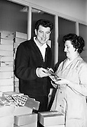 Brendan Bowyer, lead singer with the Royal Showband, picks up their latest disc from HMV at the Gramaphone Company. 1964 was a huge year for the band and included the hit for which Bowyer is most remembered 'The Hucklebuck', originally on the B-side of 'I Ran All the Way Home'. .26.05.1964