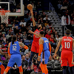 Dec 12, 2018; New Orleans, LA, USA; New Orleans Pelicans forward Anthony Davis (23) shoots over Oklahoma City Thunder center Steven Adams (12) and guard Russell Westbrook (0) during the first quarter at the Smoothie King Center. Mandatory Credit: Derick E. Hingle-USA TODAY Sports