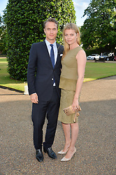 The MARQUESS & MARCHIONESS OF DOURO at The Ralph Lauren & Vogue Wimbledon Summer Cocktail Party at The Orangery, Kensington Palace, London on 22nd June 2015.  The event is to celebrate ten years of Ralph Lauren as official outfitter to the Championships, Wimbledon.