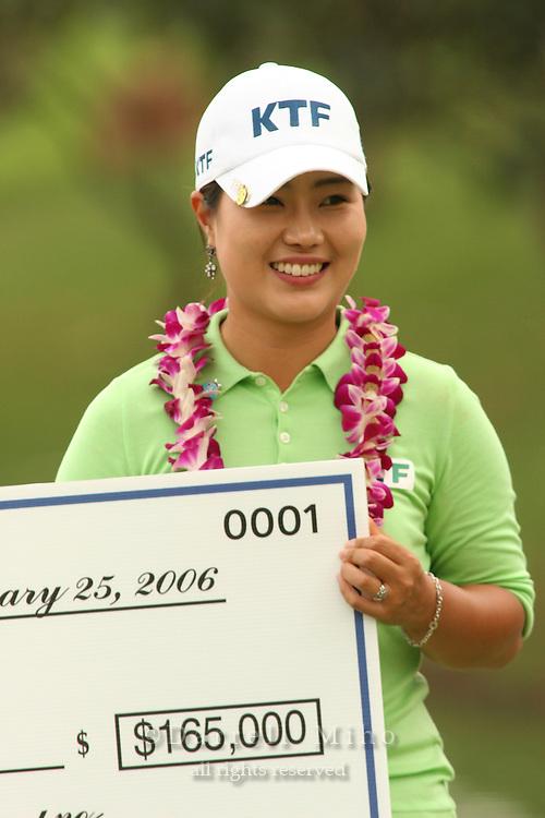 Feb 24, 2006; Kapolei, HI, USA; Meena Lee holds up her check after winning the inaugural LPGA Fields Open at Ko Olina Resort...Photo Credit: Darrell Miho.Copyright © 2006 Darrell Miho