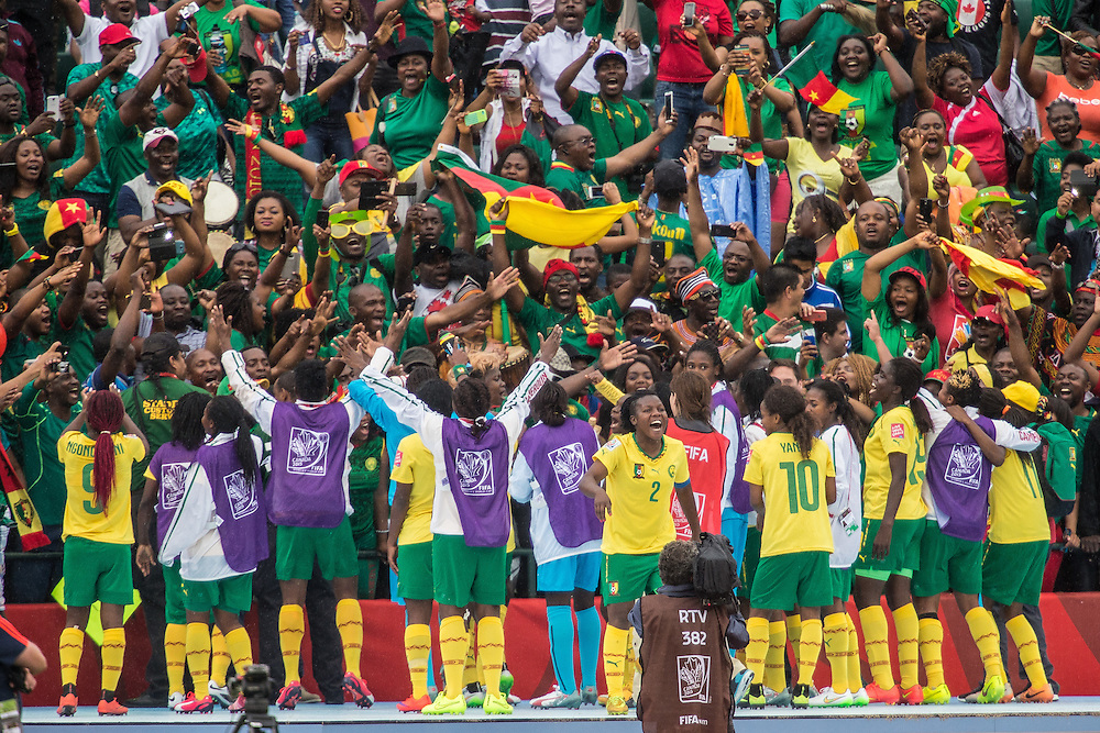Cameroon's Christine Manie (2) and her teammates celebrate their 2-1 win over Switzerland in their FIFA Women's World Cup group C match at Commonwealth Stadium in Edmonton, Canada on June 16, 2015.   AFP PHOTO/GEOFF ROBINS