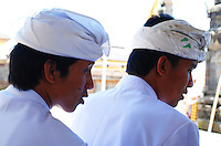 Two men at a Puri Agung ceremony on Bali, Indonesia.