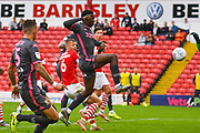 Leeds United forward Eddie Nketiah (14) scores a goal to make the score 0-1 during the EFL Sky Bet Championship match between Barnsley and Leeds United at Oakwell, Barnsley, England on 15 September 2019.