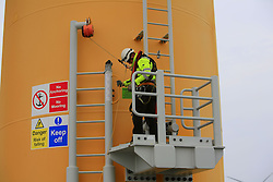 UK ENGLAND NORFOLK SHERINGHAM SHOAL 25SEP13 - Inspection engineers climb onto a wind turbine from the bow of the Tidal Transit vessel Tia Elizabeth at the Sheringham Shoal wind farm in the North Sea off the Norfolk coast, England.<br /> <br /> jre/Photo by Jiri Rezac<br /> <br /> © Jiri Rezac 2013