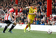 Rotherham United defender (and former Brighton player) Joe Mattock gets past Brentford forward Sergi Canos during the Sky Bet Championship match between Brentford and Rotherham United at Griffin Park, London, England on 17 October 2015. Photo by Andy Walter.