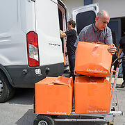 OCTOBER 6, 2017--PONCE, PUERTO RICO ---<br /> Allan Cintron Salichs, left, Executive Director of Med Centro in Ponce, loads donated Direct Relief supplies on a cart.<br /> (Photo by Angel Valentin/Freelance)