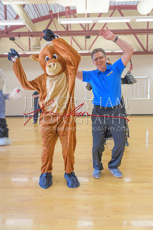 """David Raymond pioneered the field of sports mascots as the first inhabitor of the world-renowned Phillie Phanatic leads a Mascot Bootcamp in Kutztown, PA, 8 April 2016. Here he is working with """"Da Bull"""" aka Washington Post writer Sarah Larimer. Photograph by Jim Graham"""