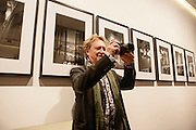 Andy Summers, former guitar player of the Police, writer and photographer, poses at Leica Gallery where there is an exhibition of his photographs in Milan, March 22, 2016. &copy; Carlo Cerchioli<br />