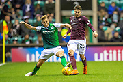 Sean Mackie (#43) of Hibernian FC tackles Marcus Godinho (#26) of Heart of Midlothian during the Ladbrokes Scottish Premiership match between Hibernian FC and Heart of Midlothian FC at Easter Road Stadium, Edinburgh, Scotland on 29 December 2018.
