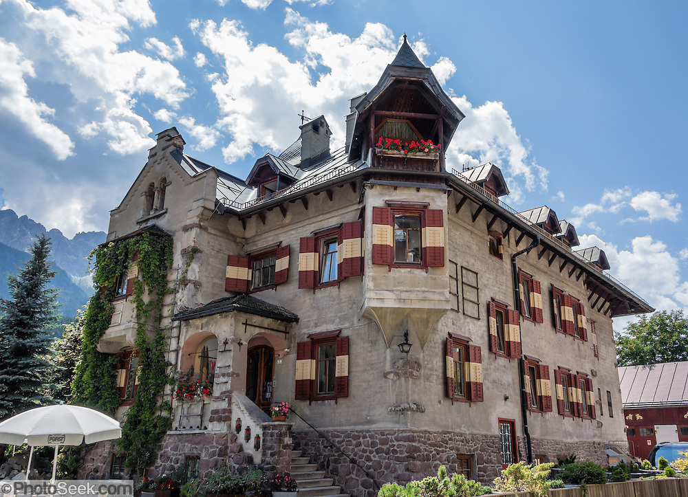 "The castle-like residence of Villa Wachtler was built in 1911 in Alpine Art Nouveau style, in Innichen/San Candido, in the valley of Alta Pusteria/Pustertal, in Trentino-Alto Adige/Südtirol (South Tyrol), Italy, Europe. Villa Wachtler is the residence of Michael Wachtler, who is founder of the town's Dolomythos Museum and is self-described as a ""discoverer, philosopher of nature, author, and film director."" Innichen is a gateway to the Sesto Dolomites (Dolomiti di Sesto / Sexten / Sextner / Sextener Dolomiten) mountains, part of the Southern Limestone Alps. UNESCO honored the Dolomites as a natural World Heritage Site in 2009."