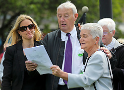 © Licensed to London News Pictures. 16/06/2017. Birstall, UK.  L to R Jo Cox's sister Kim leadbeater, father Gordon Leadbeater and mother Jean Leadbeater, singing during the ceremony.  500 school children from nine schools in the Birstall area that have joined together in Heckmondwike Green to sing songs in memory of MP Jo Cox this morning. Today marks the one year anniversary of the death of Labour MP for Batley & Spen Jo Cox. Jo Cox died after being shot & stabbed by Thomas Mair outside Birstall library where she had been due to hold a constituency surgery. Photo credit: London News Pictures