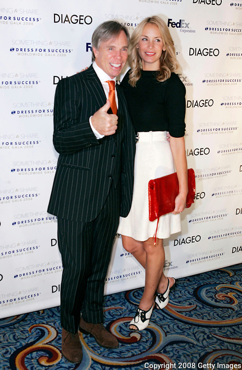 NEW YORK - APRIL 9: Designer Tommy Hilfiger and fiancee Dee Ocleppo pose at the Dress for Success 2008 Gala at the Marriott Marquis Hotel in Times Square on April 9, 2008 in New York City.