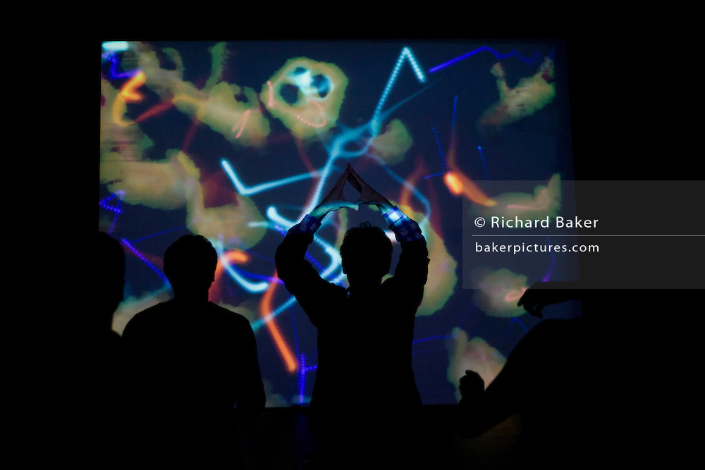 Dancers experience David Glowacki's Danceroom Spectroscopy interactive atomic art at Bristol's Arnolfini art centre.