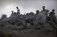 Members of the U.S. Army Second Infantry Division check their mail while members of the Korean Army keep a watchful eye for Chinese soldiers during the Korean War.  These are photos of the 2nd Infantry Division in the Korean War in 1950 or 1951.