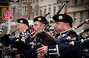 March 17, 2015 - New York, NY. Pipers exert themselves during New York City's annual St. Patrick's Day parade on 5th  Avenue. 04/17/2013 Photograph by Kevin R. Convey/NYCity Photo Wire