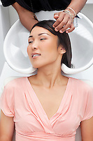 Asian woman having hair wash at beauty salon