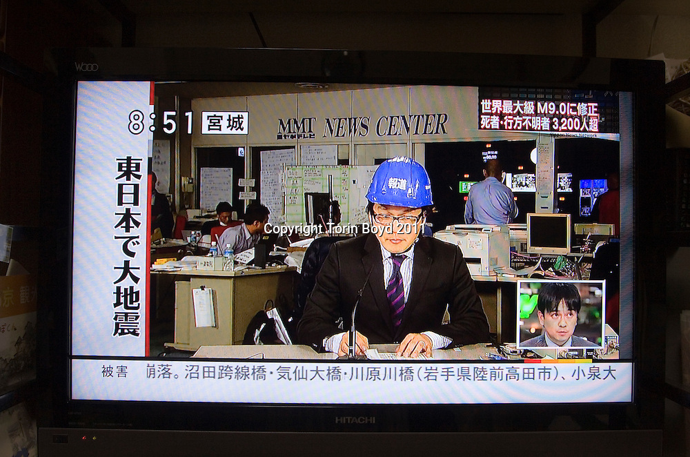 This is a series of screen shots showing Japanese journalists who all seem to be wearing hardhats while on air while reporting on the massive 9.0 magnitude quake and tsunami that struck Japan on March 11, 2011. This includes both newscasters and on site reporters.