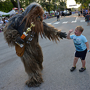 YARMOUTH, Maine --  7/21/17 --   Interstellar hero and  Guest of Cub Scout Pack 31, Chewbacca, greets Jeremy Stover, 4, of Scarborough on Friday night. The Yarmouth Clam Festival parade drew thousands of visitors from around the region and galaxy. Photo by Roger S. Duncan for the Forecaster.