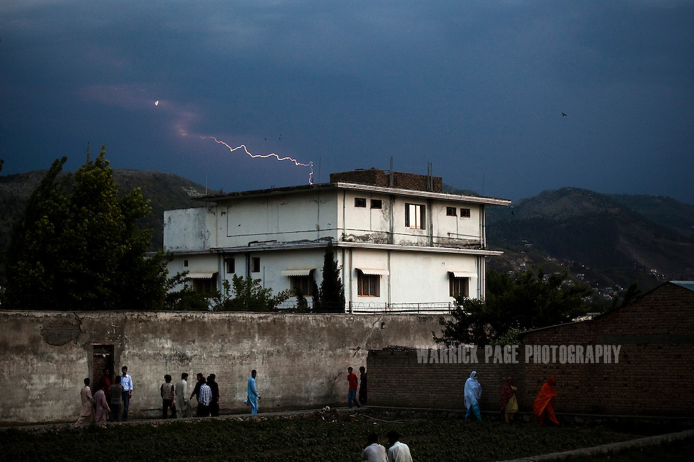 Lightening strikes in the distance beyond the compound where Osama Bin Laden was killed in an operation by US Navy Seals, on May 4, 2011, in Abottabad, Pakistan.  The operation, code-named Operation Neptune Spear, was launched from neighbouring Afghanistan by Seal Team Six. U.S. forces took bin Laden's body to Afghanistan for identification, then dumped it the Arabian Sea. Pakistan has since been widely suspected as having prior knowledge of his whereabouts as the compound was less than a kilometre from the country's biggest military academy. Osama bin Laden was allegedly responsible for supporting the bombing of the US Embassy in Nairobi, Kenya, the attack on the USS Cole and the suicidal attacks of September 11, 2001 in the US. (Photo by Warrick Page)