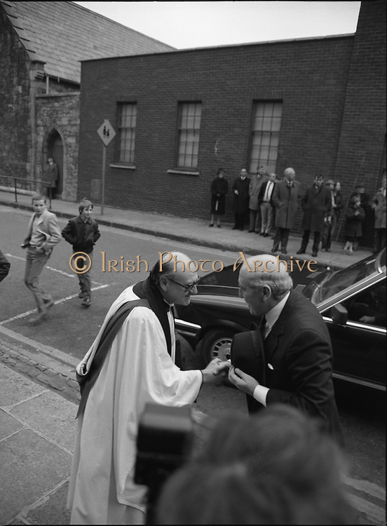 Remembrance Day Service.1983.13.11.1983.11.13.1983.13th November 1983..A remembrance service was held in St Patrick's Cathederal, Dublin,(Poppy Day) to commerate the Irish Fallen who died  whilst on service with the British Army in the two World Wars..Image of Mr Patrick Cooney,T.D.,Minister of Defence as he is greeted on his arrival at the service by Dean Griffin of St Patricks Cathedral.