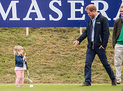TETBURY - UK - 18th June 2016: Prince William, HRH The Duke of Cambridge plays a charity polo match at the Beaufort Festival of Polo near Tetbury in Gloucestershire.<br /> <br /> Prince William was watched by his brother Prince Harry and Zara Phillips with her daughter Mia.<br /> <br /> Prince Harry gives Mia a few tips on polo.<br /> Photograph by Ian Jones