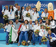 The Italian women's water polo team poses with their gold medals after defeating Greece in the Women's Water Polo final at the Olympic Aquatic Centre in Athens Thursday 26 August 2004.  Italy won the gold medal in a close 10-9 match. (Photo by Patrick B. Kraemer / MAGICPBK)